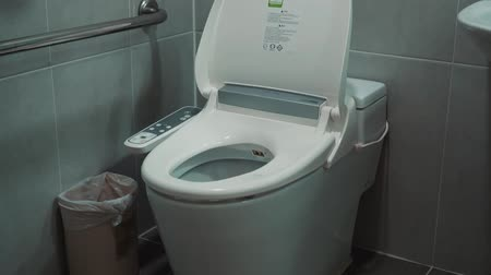 função : Toilet room with smart toilet with control panel and buttons for mode selection