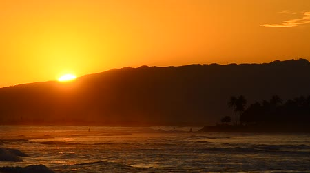napos : Sun Setting Over Mountain From Waikiki, Hawaii.