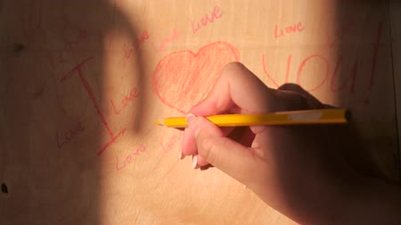 declarations : draw hearts on a wooden board about declarations of love Stock Footage
