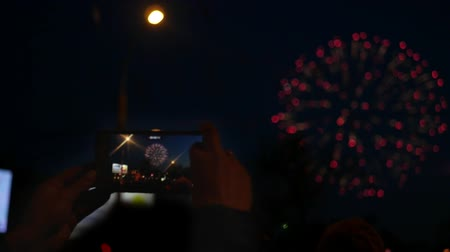 final destination : Shoot a salute on the phone, in the night sky. Slow motion. 1920x1080. Stock Footage