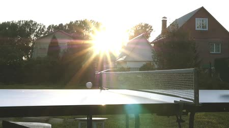 подача : To throw a ball of table tennis on the pitch in the rays of the sunset. slowmotion, 1920x1080, hd