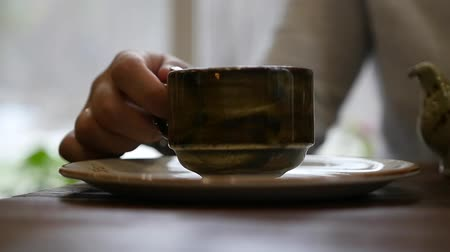 hot news : To take in hands a beautiful mug with a tasty drink, tea or coffee. slow motion, 1920x1080, full hd Stock Footage