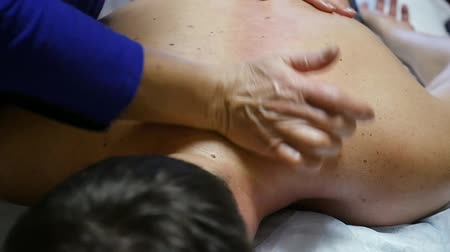 Therapeutic back massage, shoulder area. Warm-up movements. HD, Stok Video
