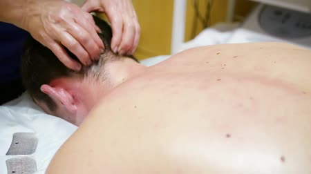 Massage the back of the head and neck of a man. HD