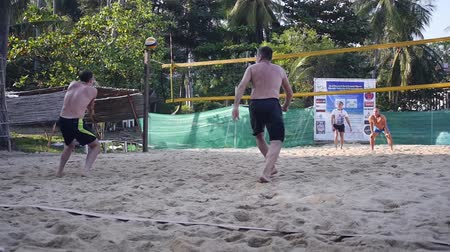 16022018 Thailand, Koh Samui, Chaweng Noi beach. Men play beach volleyball, they take the ball on the field and pass through the net. HD, 1920x1080. slow motion