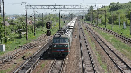 mozdony : LVIV, UKRAINE - MAY 2018: A freight train rides the railway station Stock mozgókép