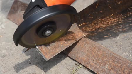 angle grinder : Worker cuts metal with a grinder, sparks fly