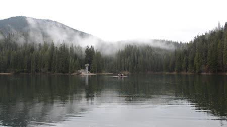 tutaj : Rainy foggy day on the mountain lake