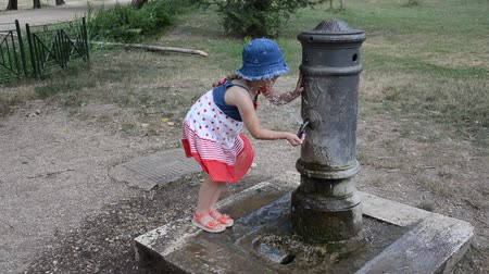 drinking water supply : Girl drinking water from the drinking fountain