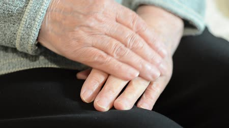 Wrinkled hands of an old woman Stock Footage