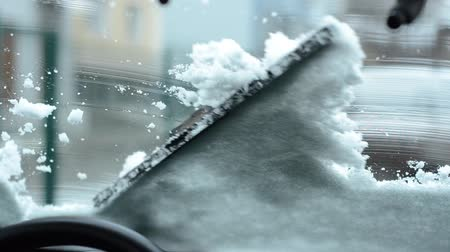 scraper : Car wiper blades clean windshield from snow in winter Stock Footage