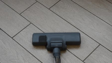 Vacuum cleaner working tiled house