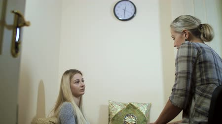 анализ : girl listening to a psychologist sitting on a sofa against the wall with a clock