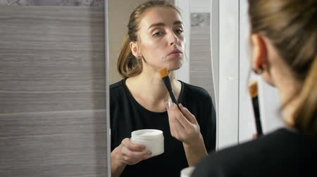 пятна : girl in the bath near the mirror with a brush, apply a face mask, acne
