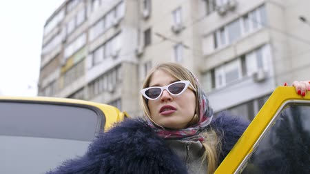 пятна : Girl in modern urban style posing on the street near the tram, on the background of the car and high houses of the Soviet era