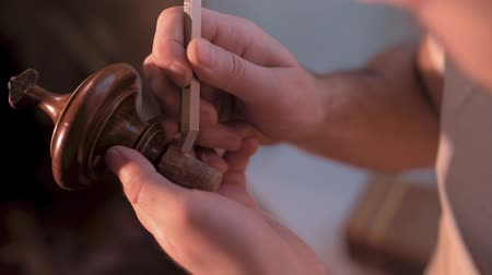 cabinetry : a man at home chisels a wooden figure from furniture Stock Footage