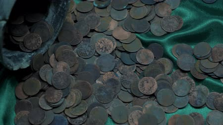 doubloon : rusty old coins are lying on a green cloth