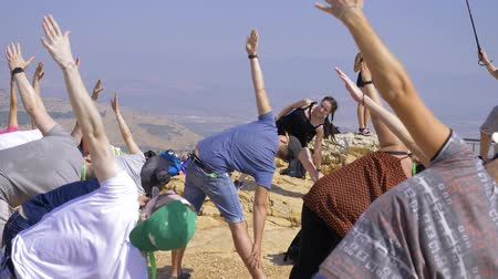 взял : Israel Mount Arbel - July 21, 2019. a group of people took a pose on Mount Arbel which they showed them, instructor
