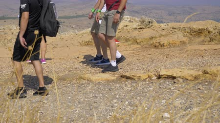 альпинизм : Israel Mount Arbel - July 21, 2019. a group of tourists are scrolling while some photos Стоковые видеозаписи