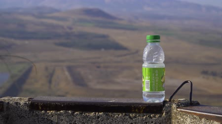 kippur : Israel Golan Heights - July 21, 2019 bottle of water in the background, view from Golan Heights Stock Footage