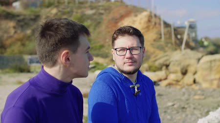 close-up, two gay guys from the LGBT community, look at each other, and smile Stock mozgókép