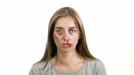 batido : portrait of a girl on a white background with bruises and abrasions after domestic violence