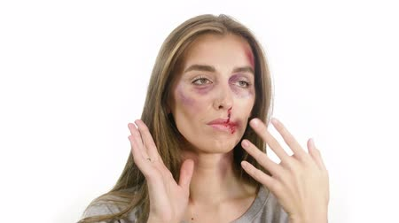 batido : portrait of a woman on a white background, with traces of domestic violence, bruises of a sadina, nosebleed lips, a girl posing to the side