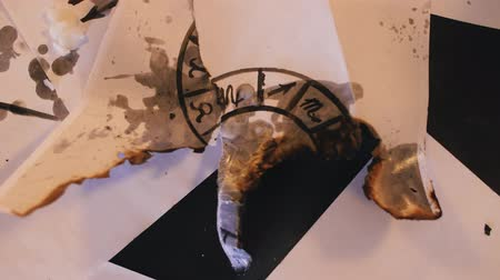 büyücü : close-up of a burnt zodiac ring Stok Video
