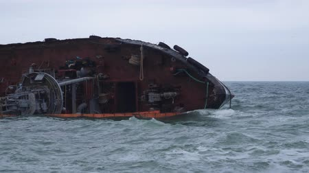 a close-up of a cargo ship lying on its side in the city of Odessa not far from the coast