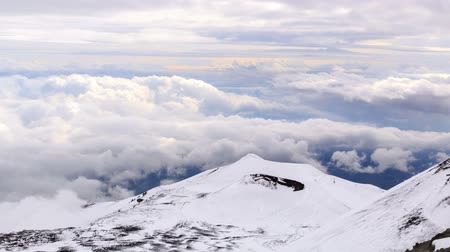 picos : One of the extinct craters of Mount Etna on the background of clouds. Time Lapse