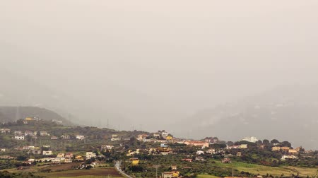 szicília : Village in mountain valley fog hides. Sicily, Italy. Time Lapse Stock mozgókép