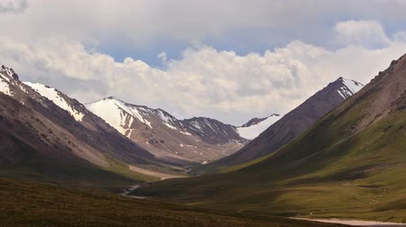 geological feature : Clouds in the mountains. Kyrgyzstan, Central Tien Shan. River Valley Tuz