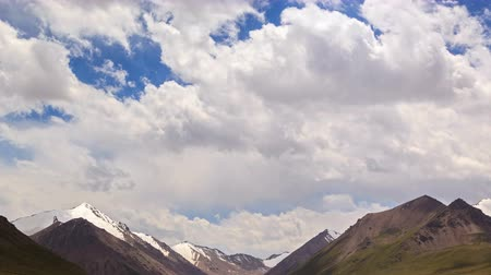 geological feature : Clouds in the mountains. Kyrgyzstan, Central Tien Shan. River Valley Tuz. UltraHD 4K. UltraHD 4K