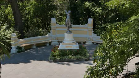 subtropics : Statue of a girl. Arboretum Sochi, Russia - July 19, 2015: a unique collection of subtropical flora and fauna. UltraHD 4K Stock Footage