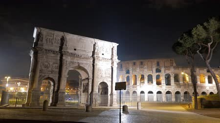 costantino : Arch of Constantine and Colosseum at night. Rome. Italy. UltraHD 4K