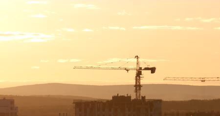 stroj : Tower crane against the sky in the afternoon. Backlight. Ekaterinburg, Russia. UltraHD (4K)