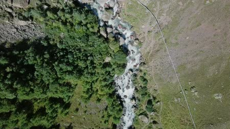 ágil : Elbrus from the north. The Sultan waterfall on the Kyzyl-Su river. Aerial view. Kabardino-Balkaria, Russia, From Dron, HEAD OVER SHOT with rotation Stock Footage