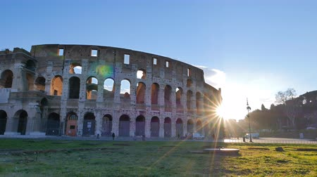 amphitheatre : The sun comes out from behind the Coliseum. Rome, Italy