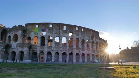 flavian : The sun comes out from behind the Coliseum. Rome, Italy