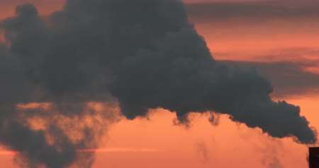 ekaterinburg : Silhouette of smoke from the chimney against the sky before sunrise. Telephoto lens. Mirage in the atmosphere