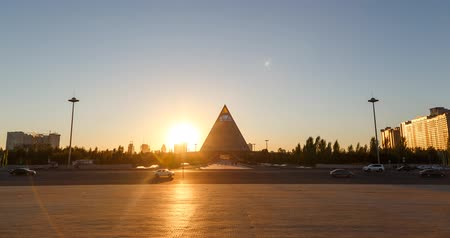 foster : Astana, Kazakhstan - September 4, 2016: Palace of Peace and Reconciliation at sunset. TimeLapse