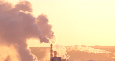 ekaterinburg : White smoke and steam coming from the chimneys, early morning, backlight. Telephoto lens, panorama. Mirage in the atmosphere Stock Footage