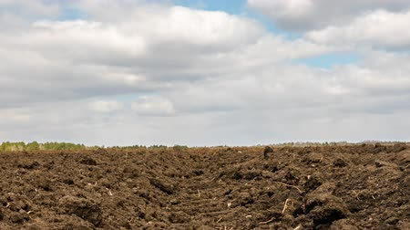 furrow : Clouds over arable land close-up. Time Lapse