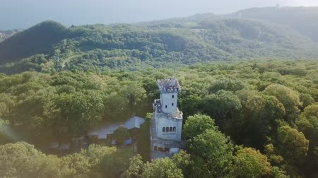 krasnodar city : Mountain with a tower covered with forest. Mount Akhun, Sochi, Russia. Text to English written on asphalt - Akhun, From Dron, Point of interest Stock Footage