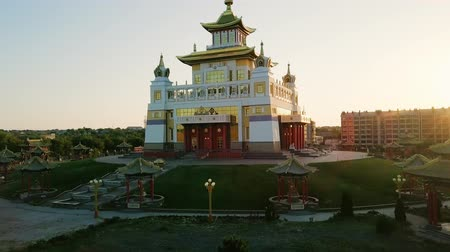 buddhista : The golden abode of Buddha Shakyamuni at sunrise is the largest Buddhist temple in the Republic of Kalmykia, one of the largest Buddhist temples in Europe. Elista, Russia, From Dron Stock mozgókép