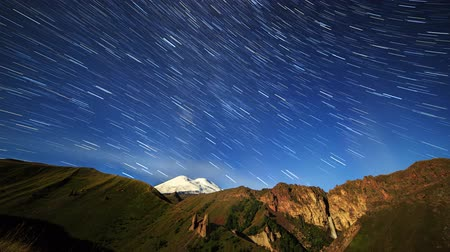 plateau : Stars draw lines and clouds over Mount Elbrus. Night landscape. Russia