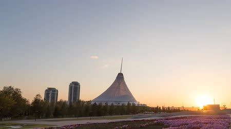 khan : Astana, Kazakhstan - September 5, 2016: Shopping center built in the shape marquee. Sunset. Khan Shatyr, Time Lapse