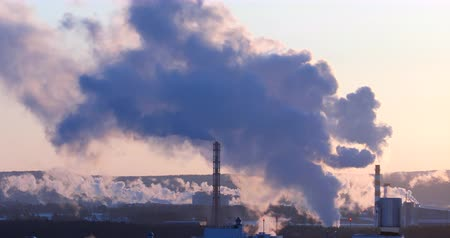 ekaterinburg : White smoke and steam coming from the chimneys, early morning, backlight. Telephoto lens. Mirage in the atmosphere