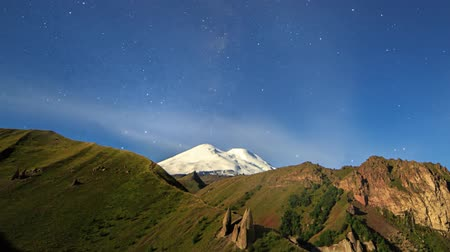 plateau : Stars and clouds over Mount Elbrus. Night landscape. Russia Stock Footage