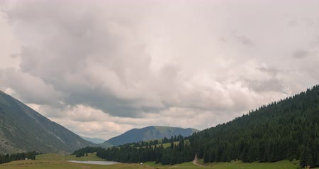 kul : Clouds over the mountains. Grigoriev gorge, Issyk-Kul, Kyrgyzstan. TimeLapse